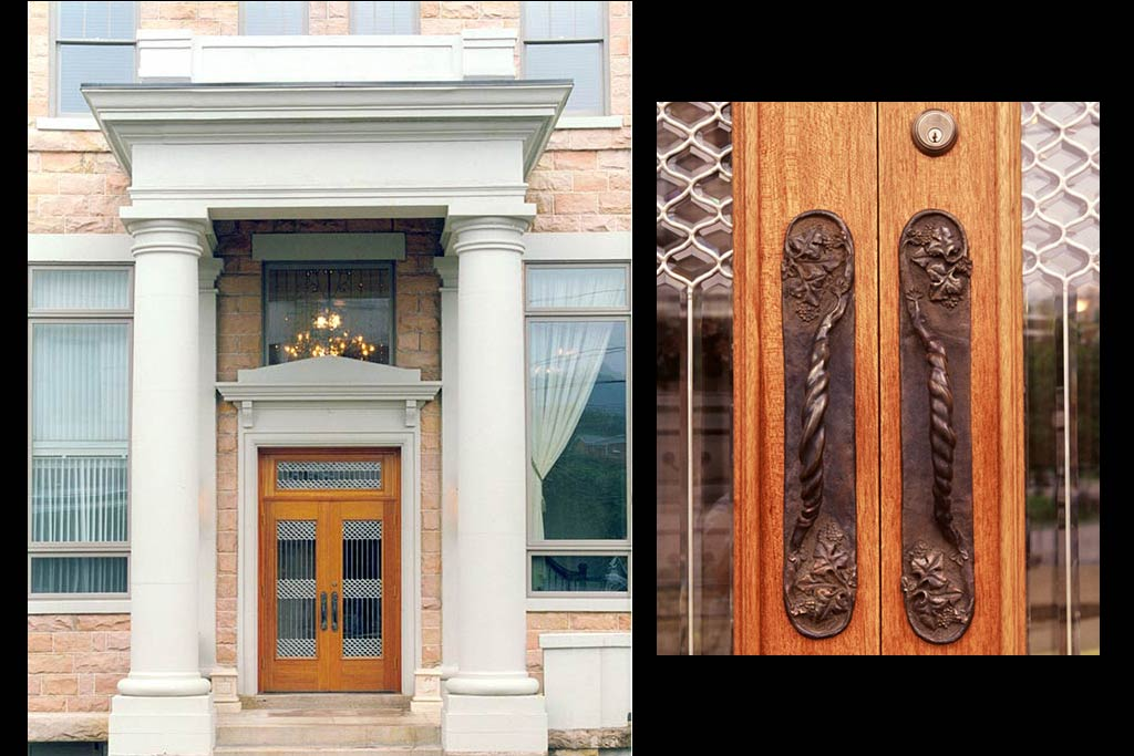Entrance to the Cornerstone Cafe in historic Nicholas County Banking building. The inset shows custom bronze grapevine door pulls by sculptor Bill Hopen.