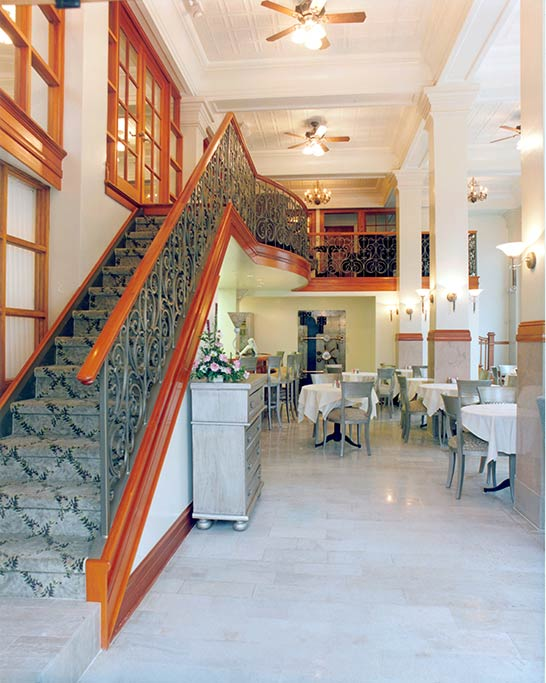 Much of the interior of the restaurant was returned to the original layout. The marble floors and columns remain. A mezzanine level from an earlier remodel was kept additional seating. A new wrought iron railing and mahogany trim were added.