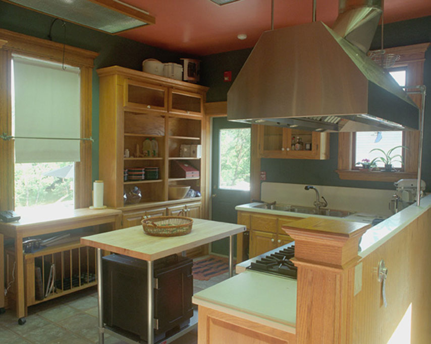 The small original kitchen was enlarged to handle some commercial equipment.