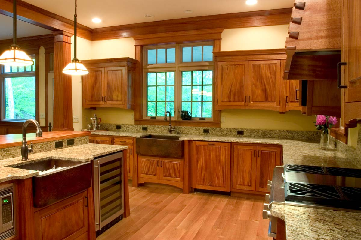 "Corlis designed this kitchen to be ""unfitted"", a mix of furniture & cabinetry. There are two hammered copper apron front skirts and an island equiped with a wine cooler, microwave and warming drawer."