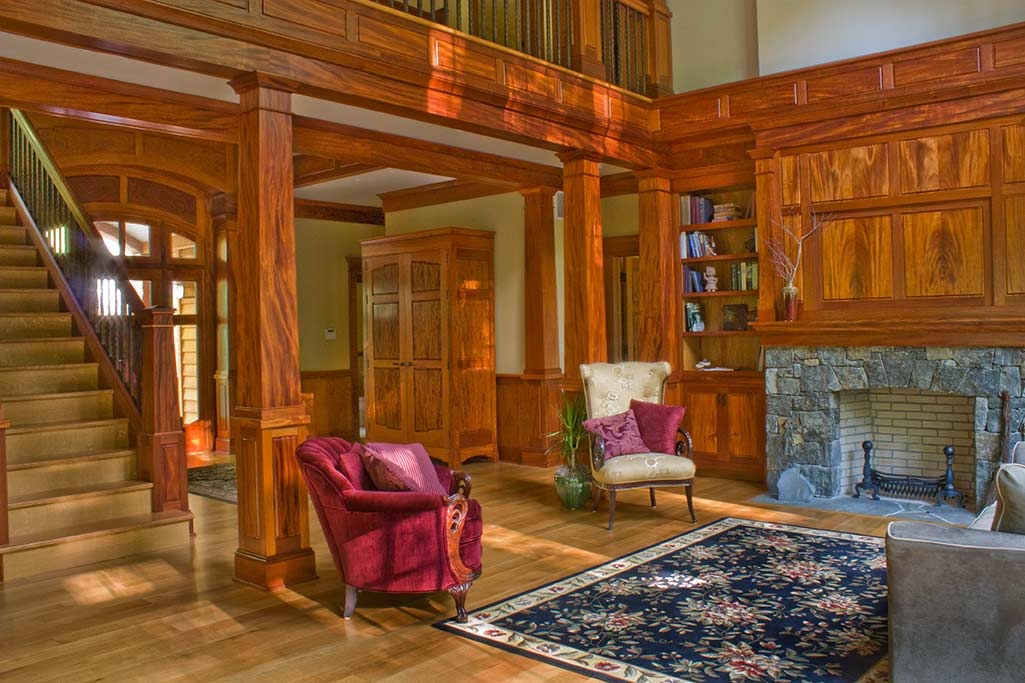 The sun streams in the large great room windows most of the morning, highlighting the mahogany entertainment cabinetry. The bookmatched door over the fireplace retracts up into the upper woodwork to offer a space for up to a 50\x1d T.V..