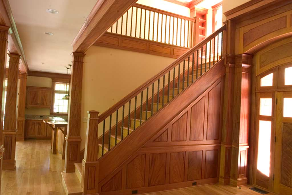 The foyer is completed by the paneled stair wall. It is made with single boards in matched sets, with the grain continuing up the wall.