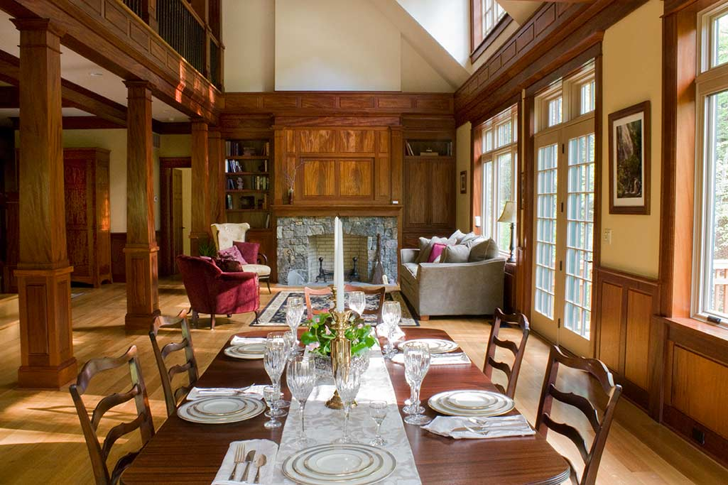 While we currently are showing the house with place settings for six, the dining room could easily support much larger table & chair arrangements for up to 10 or 12.  The French door on the right hand side between the dining and living areas leads to an observation deck over the creek.