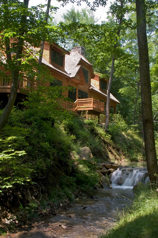 Sugar Creek flows behind Artisan House. You can hear the soothing sounds from 1600 square feet of deck and terrace overlooking the creek and yard.