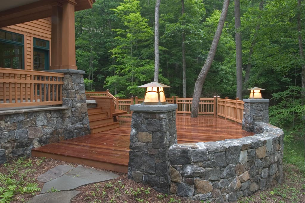 The granite sitting wall surrounds the Ipe deck and is topped with handmade copper arts & crafts lanterns with iridescent glass.