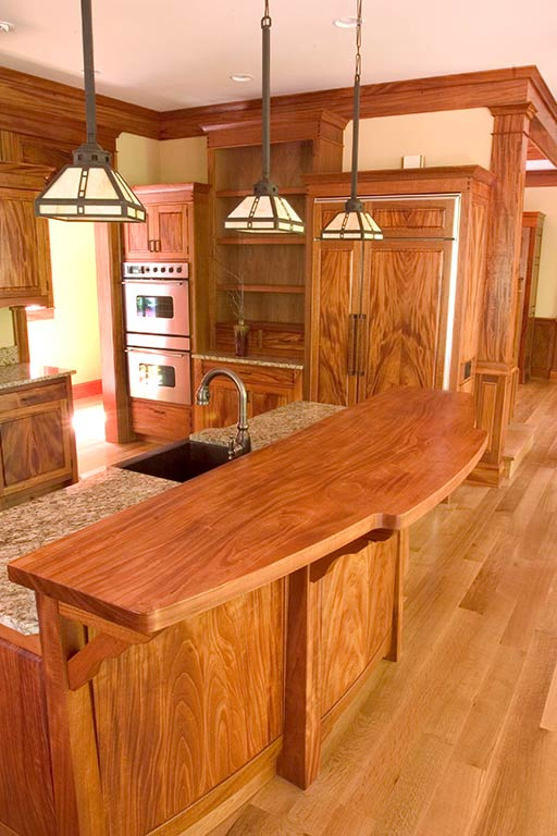 Corlis Design's shop, Signature Woodworks, handpicked mahogany for the whole house from sources developed over 25 years. Note the one piece countertop island.