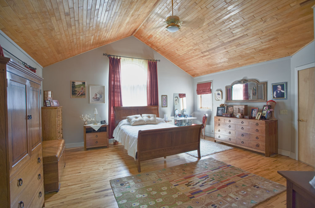 The master suite shares the cathedral ceilings with the rest of the house. The large windows and cherry ceilings are another commonality.
